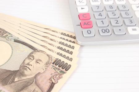 Japanese money and calculator Stock fotó