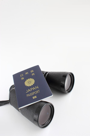 Binoculars and passport 写真素材