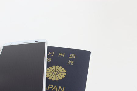 Japanese passport and smartphone 写真素材