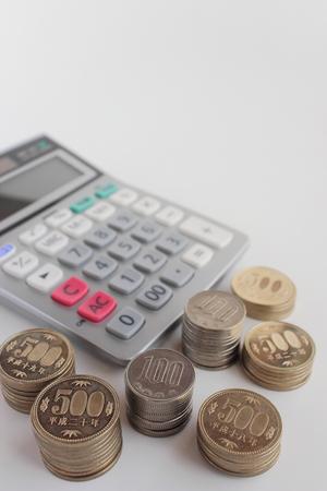 Calculator and Japanese money Stock Photo