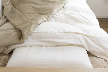 Bed and blanket Banco de Imagens