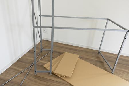 Assembling desk under assembly