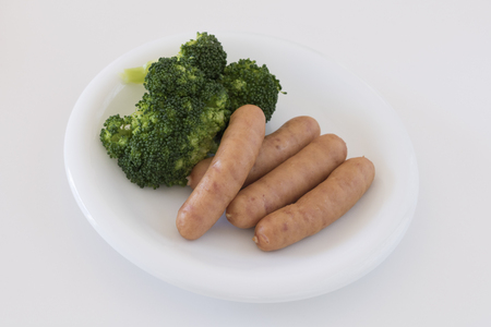 Served sausage and broccoli