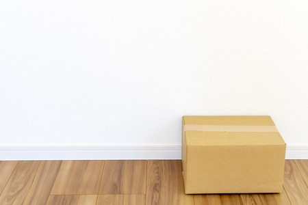 Room of newly built house and cardboard box Фото со стока