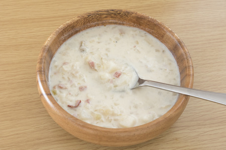 Clam chowder in a wooden dish