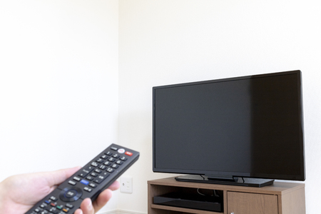 Image manipulating TV with remote control Stock Photo