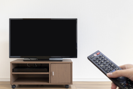 Image manipulating TV with remote control 版權商用圖片