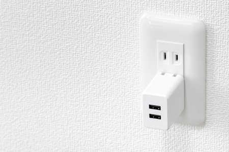 Outlet and USB power adapter Stock Photo