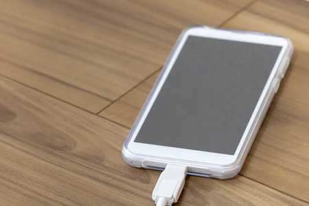 Charging smartphone from outlet