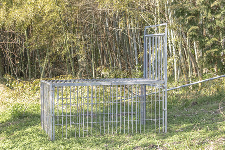 Cage of traps for wild animals Фото со стока