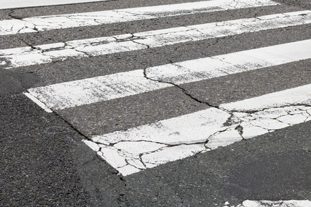 Close up of a cracked crosswalk