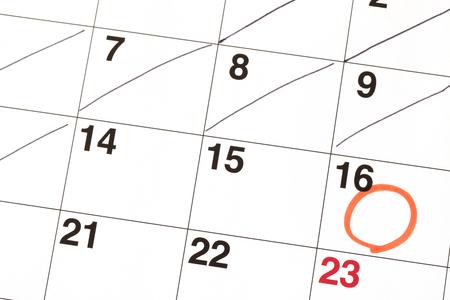 Red circle mark written on the calendar 写真素材