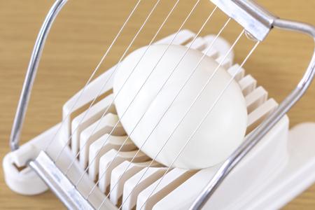 Image of using egg slicer