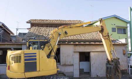 Demolition work of wooden house Фото со стока