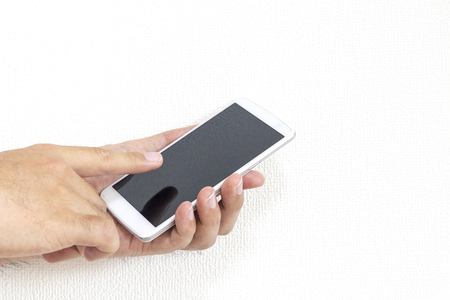 Man hand operating a smartphone