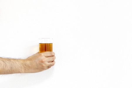 Man hand with glass of tea Archivio Fotografico