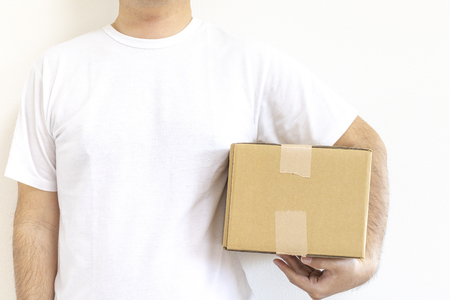 Standing man with cardboard box