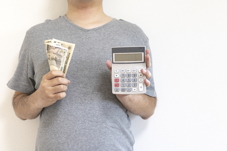 Man with calculator and japanese money