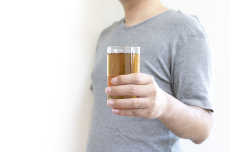 A man with chilled barley tea Imagens