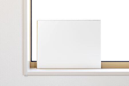 Sketchbook set against the window