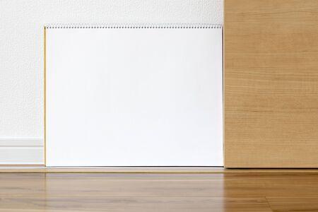 A sketchbook set up on a sliding door
