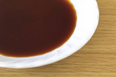 Soy sauce in a small dish Imagens