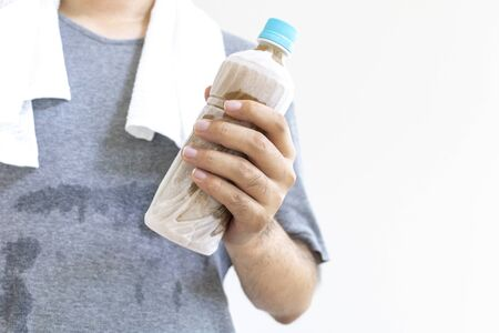 Man with plastic bottle of frozen tea