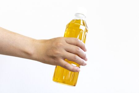 Woman hand holding plastic bottle with tea Stock Photo