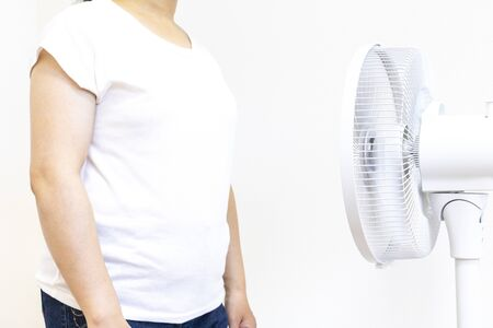 Cool woman with electric fan