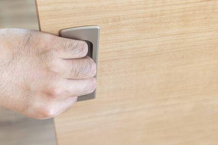 Mans hand with a sliding door knob Stockfoto