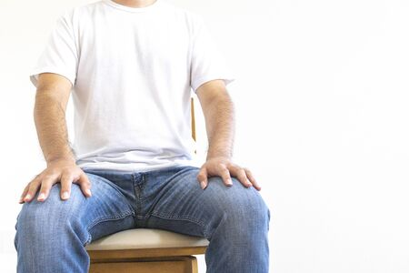 Man sitting on wooden chair