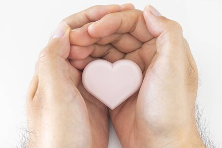 Male hand holding a heart Stock Photo