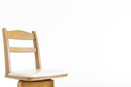 White wall and wooden chair Banco de Imagens
