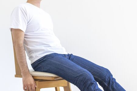 Male sitting on chair in bad posture