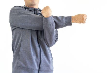 Men wearing gray jersey doing preparatory exercise