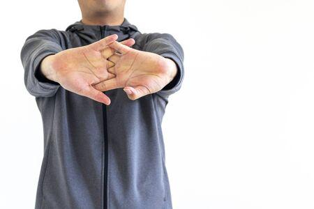 Man wearing gray jersey stretching