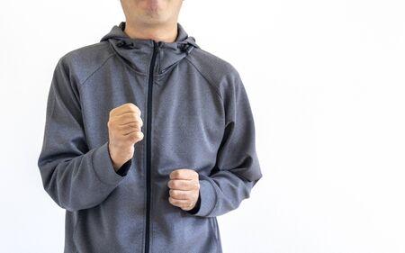 A man wearing a gray jersey doing a fist