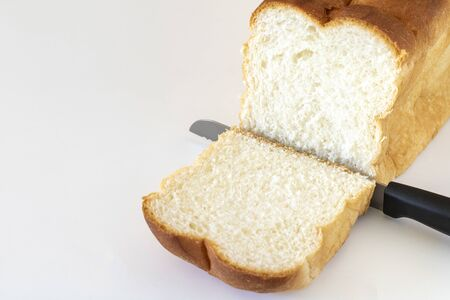 A loaf of bread and a bread knife 스톡 콘텐츠