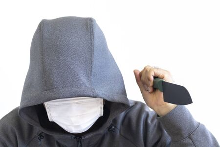 Suspicious man holding a knife and hiding his face