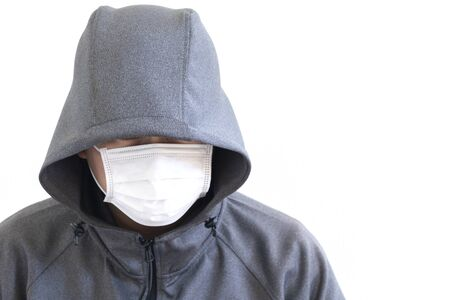 Suspicious man wearing a hood and mask