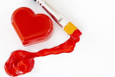 Heart figurine and Paintbrush with red paint
