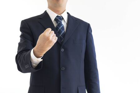 A man in a suit holding a fist
