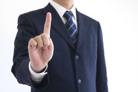 Men in suits pointing their fingers up Stock Photo