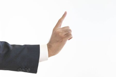 Man's hand in suit pointing finger up