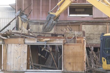 Demolition of old wooden house in Japan