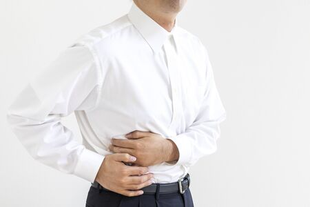 Men in business shirt suffering from holding their stomach