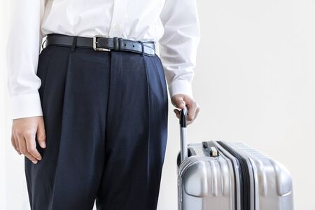 Man in a business shirt with a suitcase Stock fotó