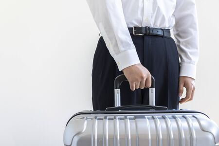 Man in a business shirt with a suitcase Stock Photo