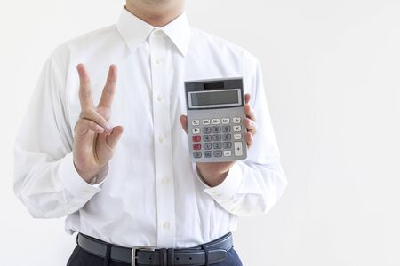 A man in a business shirt with a calculator Stock Photo