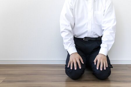 Man in business shirt sitting on the floor and resting